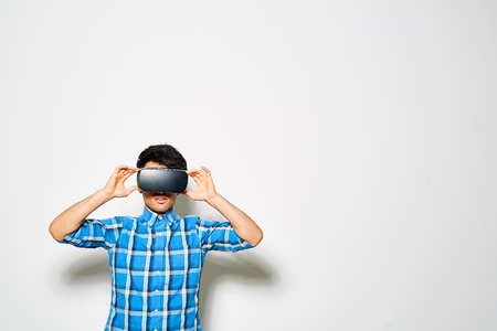 Playing Game with VR Headset Stock Photo