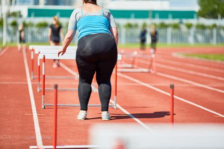 Woman by hurdle