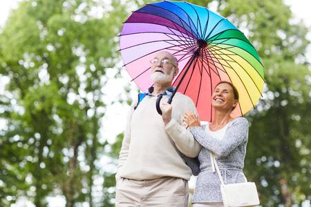 Seniors under umbrella