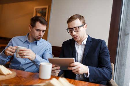Businessmen in cafe Stock Photo