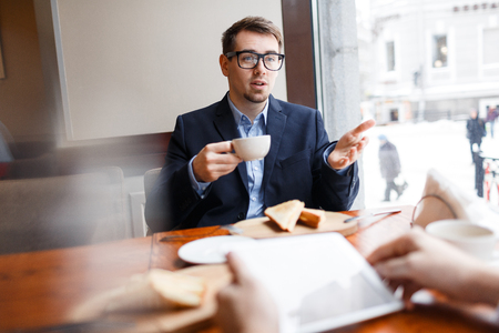 Conversation with co-worker Stock Photo