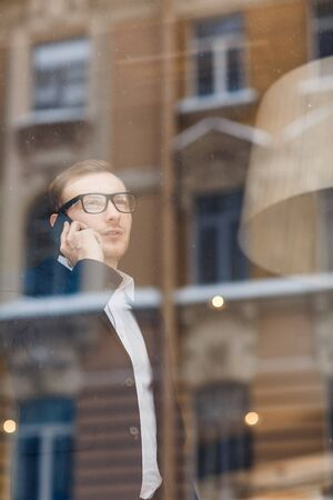 Agent by window Stock Photo