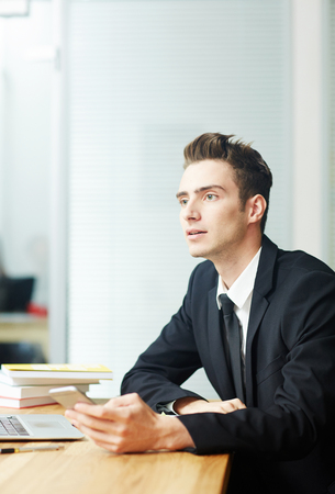 Portrait of Pensive Young Manager Banco de Imagens