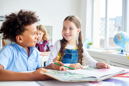 Discussion at reading lesson Stock Photo
