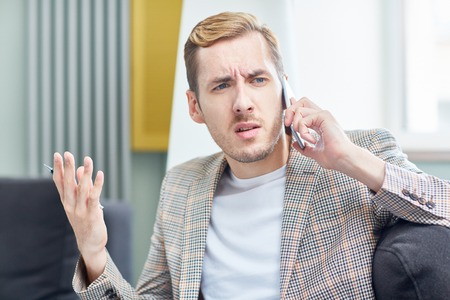 Having Tense Telephone Conversation Stock Photo