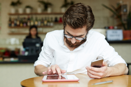 Man with gadgets Stock Photo - 87204080