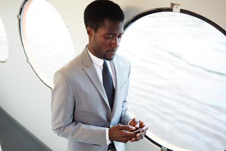 Businessman messaging Stock Photo