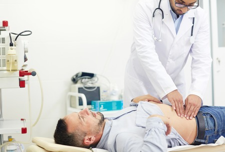 Doing Abdominal Palpation Stock Photo