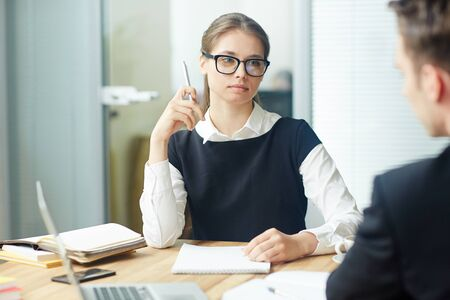 Woman listening to colleague