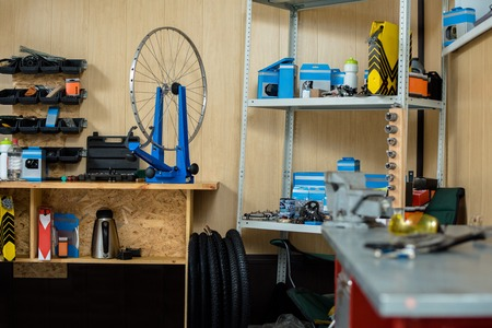 Empty bicycle repair workshop with necessary tools and spare parts