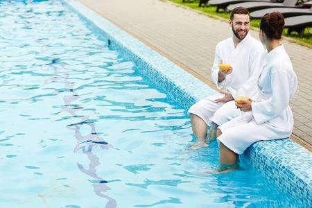Talk by swimming pool