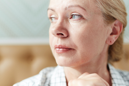 Portrait of Pensive Middle-Aged Woman