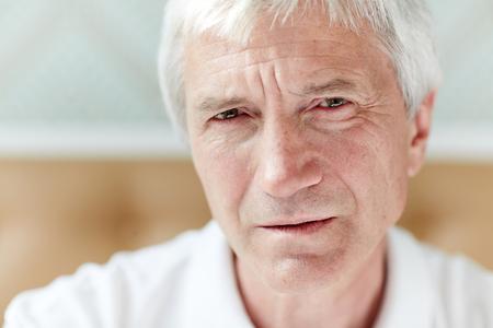 Portrait of Gloomy Senior Man
