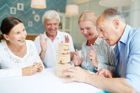 Playing Board Game with Friends Stock Photo