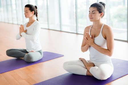 Practicing Yoga at Health Club