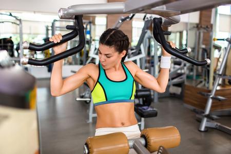 Exercising on Shoulder Press Machine Reklamní fotografie