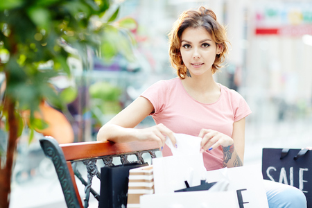 lady in peach shirt with purchase Stock Photo