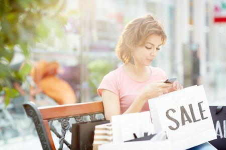 Shopper woman texting Stock Photo