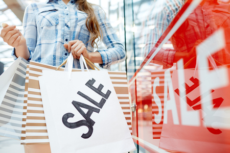 woman hold Sale paperbags Stock Photo