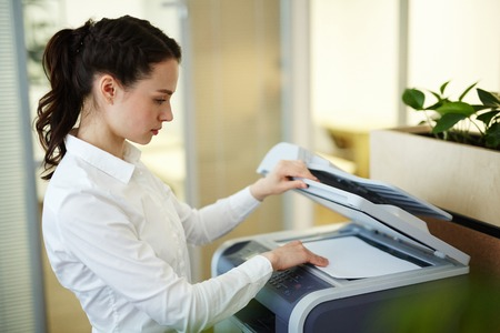 Photocopying working in office