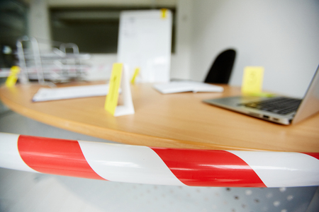 Crime scene in office bound by police tape to save fingerprints and other evidence
