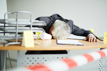 man gedood op het werk Stockfoto