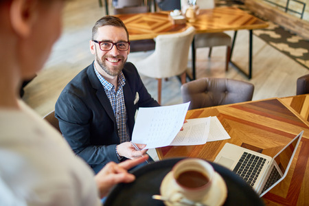 Financial Manager Working from Cafe Stock Photo