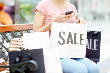 Messaging after shopping Stock Photo