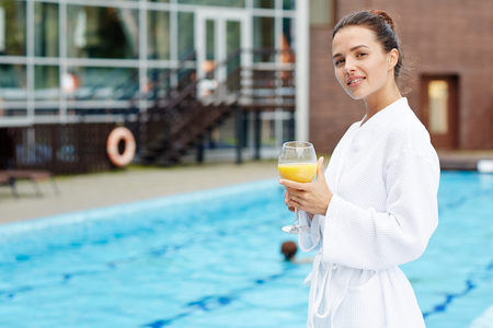 Woman by swimming-pool Stock Photo
