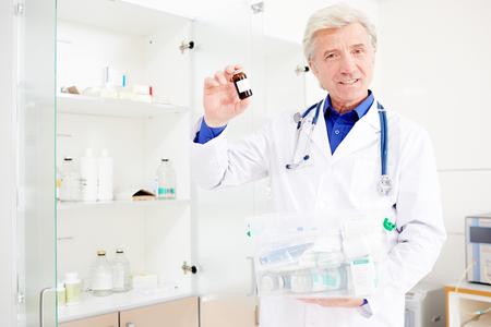 Mature pharmacist