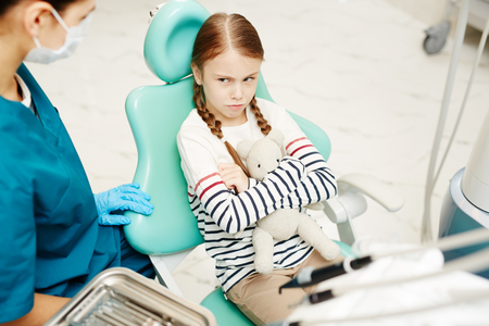 Reluctant to have dental check-up Stock Photo