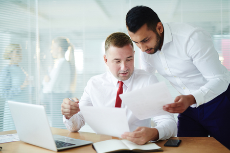 two guy working on Paperwork Stock Photo