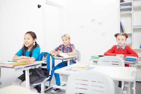 Classmates at lesson Stock Photo