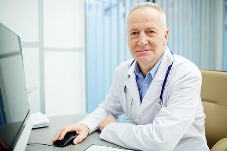 Senior clinician Stock Photo