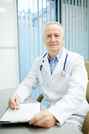 Doctor at workplace Фото со стока