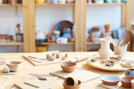 Assortment of supplies for clay craft on workplace of creative master Stock fotó