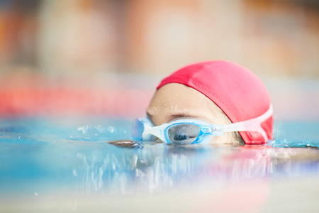 Top of human head in swimwear can be seen during training in water Stock Photo - 94542222