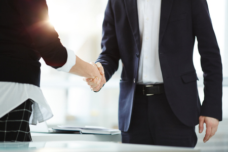 Handshake of successful business partners after negotiation and signing new contract Stock Photo