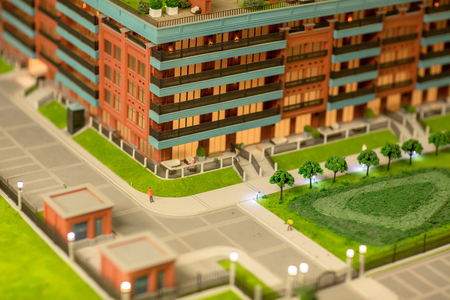 Street in new block of flats and park on layout of modern city Stock Photo