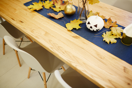 Holiday wooden table decorated to the Halloween