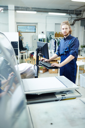 The operator of the printing house works at the typographical machine Stock Photo