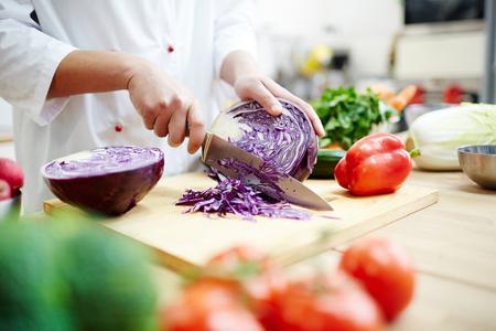 Cutting cabbage 스톡 콘텐츠
