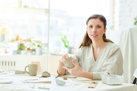 Woman making mugs