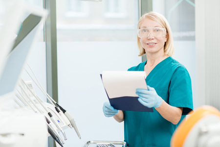 Dentist with document