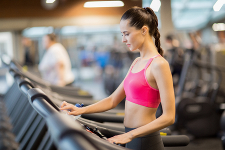 Girl on treadmill Stockfoto