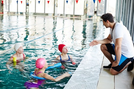 Trainer and swimmers Stock Photo - 101255751