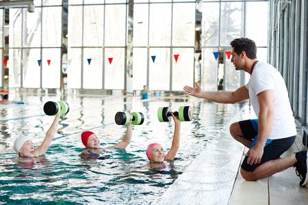 Exercising in swimming-pool Standard-Bild - 101255775