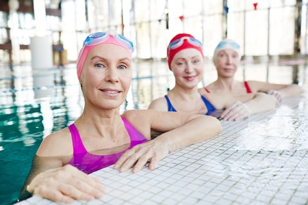 Senior sportswomen in swimming pool 스톡 콘텐츠