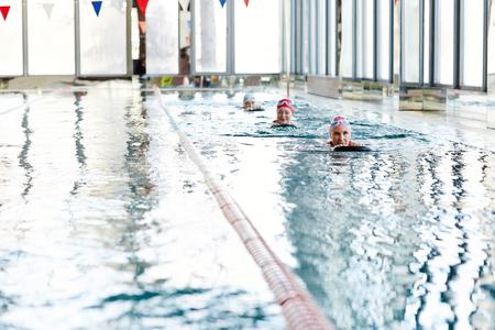 Women swimming Stock Photo