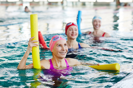Aerobics in swimming pool Stock Photo